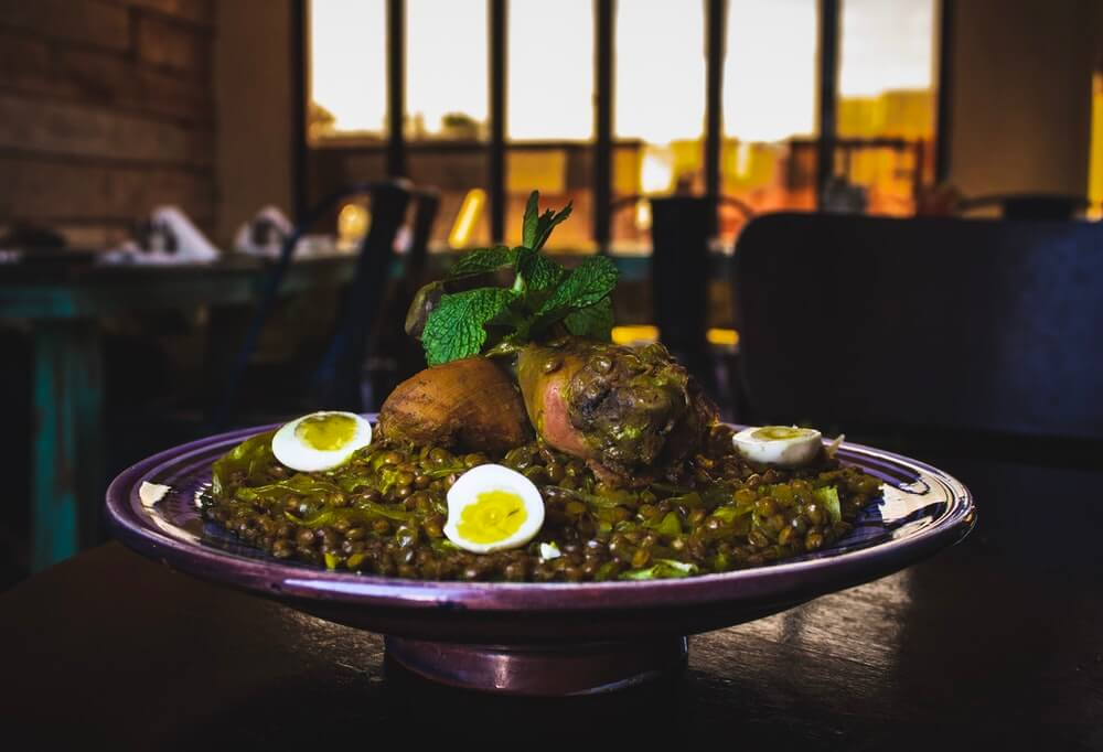 Plate with cooked green lentils