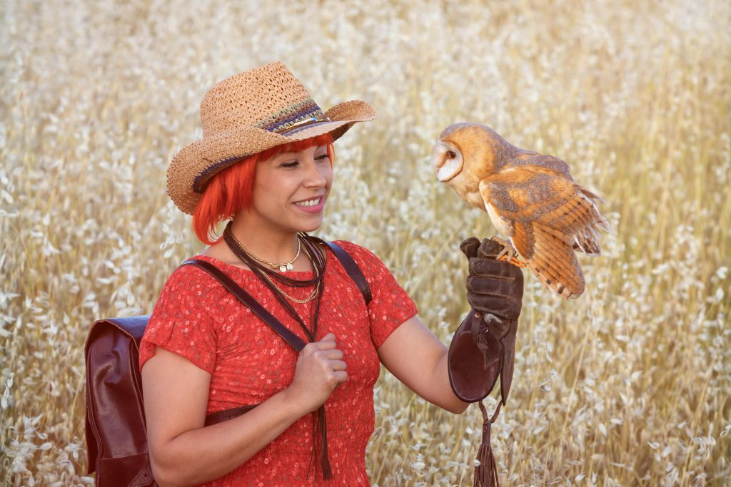 woman on a training for keeping owls as pets
