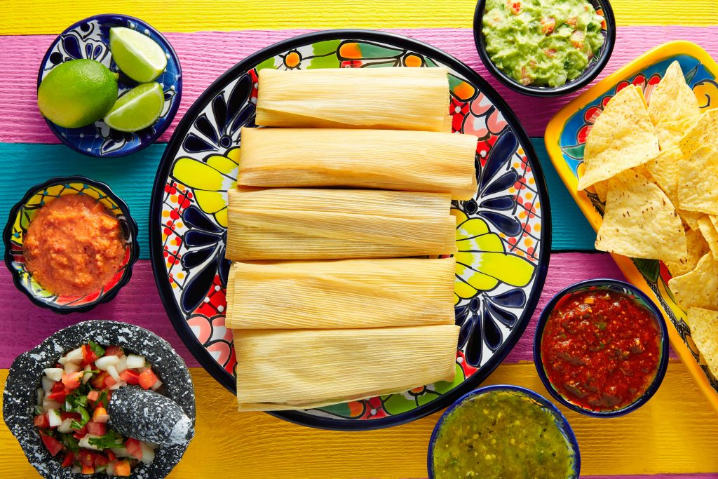 example dishes on what to serve with tamales in colorful bowls